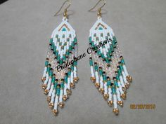 Native American beaded earrings with fringe by EagleplumeCreations on Etsy https://www.etsy.com/listing/224232909/native-american-beaded-earrings-with