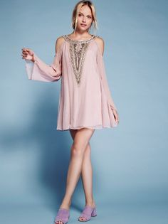 Beaded Luna Mini | Long sleeve mini dress featuring an ethereal silhouette with an open V-shaped back and sweet shoulder cutouts. Beautiful beading and embroidery along the front, back and sleeve cuffs. Sheer, gauzy fabrication. Lined.
