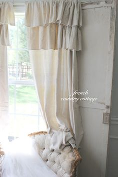 Curtains from Lowe's drop cloths -- sounds perfect for our 3 season room.