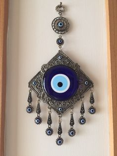 A personal favourite from my Etsy shop https://www.etsy.com/listing/289735191/evil-eye-wall-hanging-nazar-boncuk-evil