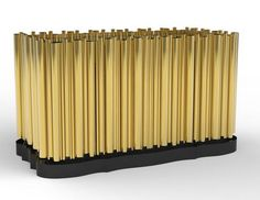 Boca do Lobo Symphony Sideboard With a vision to understand the past and interpret it through cutting-edge technology and contemporary design, we have created this emotionally evocative furniture piece passionately inspired by music. A cluster of polished brass tubes envelope an exotic wood structure, creating a harmonious artful juxtaposition to rhythm of the pipes. #HPmkt