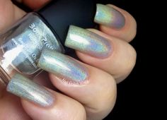 Born Pretty Holo Polish Full post here : http://www.nailpolishwars.com/2013/07/born-pretty-holo-polish-swatch-review.html  Use the Born Pretty Holo Polish : http://www.bornprettystore.com/holographic-polish-c-268_106_389.html  Use the code  DQL91  for a 10% discount!