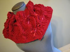 red knitted scarf with ribbons