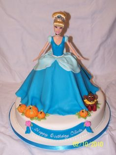 This is a cinderella doll cake that I made for a friends daughter. It has a 12 inch base and the Wilton Wonder mold pan, both WASC cake. Vanilla buttercream and MMF. All decorations are MMF as well, including the bodice. I really like how this cake turned out. Inspiration came from the many Cinderella doll cakes on CC, especially the one done by FredBarnie. TFL.