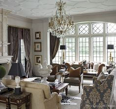 Inspired by old Newport but tweaked to satisfy contemporary tastes for airiness and light, a new Tudor-style home overlooking the Farmington Valley enfolds its owners in grandeur.