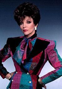 Joan Collins as Alexis Carrington wearing shoulder pads