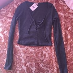 NWT- Brandy Melville Crop Top New with tag. Perfect condition. Final price. Unless you bundle with 3 other shirts from my closet for 40$ the shirt must be listed for 10$ to be included in promotion. Can only get one brandy Melville unless listed for 10$. Brandy Melville Tops Crop Tops