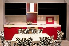 #Kitchen Idea of the Day: Modern Black and Red Kitchen, with a table and Zebra patterned chairs.