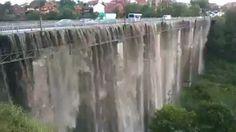 Heavy raining turns a bridge into a waterfall.