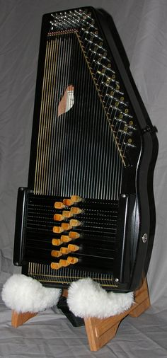 Black Sparrowharp-- economy price with an expensive sound-- smaller size for smaller adults or children-- this is a seriously COOL looking little autoharp and if I could afford another, I would add one to my family of autoharps. :)