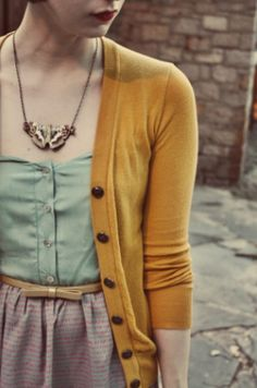 this is basically the color palate, minus the purple. Light sage and mustard yellow, with pops of light coral