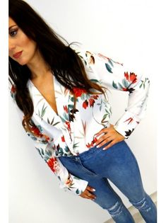 8bbaa7b32d Semi sheer white bodysuit with floral print allover. Long sleeved shirt  style with wrap front