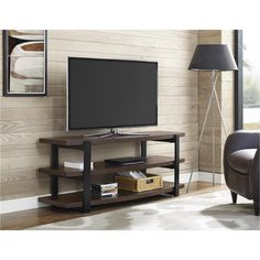 """Create a stunning home entertainment system in your very own living room with the Ameriwood Home Castling TV Stand. This TV Stand features 3 curved, open shelves to easily place your cable box, DVD play, gaming system, DVDs, games and more. Beautiful black metal sides provide a sturdy structure for the 3 dark brown Espresso shelves. The industrial and modern look of this TV Stand will look great in your living room. TV Stand accommodates most flat panel TVs up to 70"""" wide. Castling TV Stand…"""