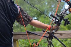 Watch pro archer, David Houser, demonstrate the correct form for shooting angled shots with a bow and arrow.
