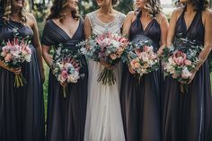 Slate grey twobirds Bridesmaid dresses with Protea wedding bouquets | A real wedding featuring our multiway, convertible wrap dresses