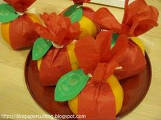 Tangerines and mandarin oranges are symbolic treats at Chinese New Year, representing luck and fortune. Set them out in bowls as decorations or dress them up and give them to friends and coworkers to say Happy New Year. This pretty presentation is in a tutorial at the I Like Papercutting blog.