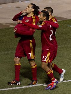 Real Salt Lake's Fabian Espindola (7) puts the ball under his shirt and blows a kiss to his pregnant wife after scoring a first half goal. Real Salt Lake vs. New York Red Bulls on March 17, 2012