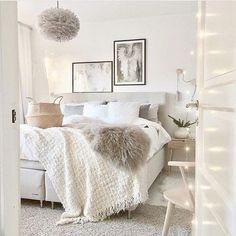 Clean white bedroom with neutral accents
