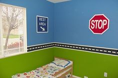 DIY traffic signs on wall, and a magnetic paint strip for car play.