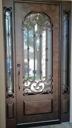 Custom wrought iron door and sidelights aaleadedglass.com
