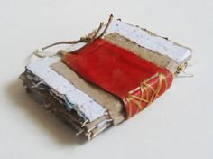 Handmade paper journal crude bound, red, brown, and white with handmade string paper. great idea for unique photo album