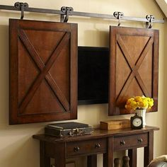 small interior doors and decorative panels for hiding tvs