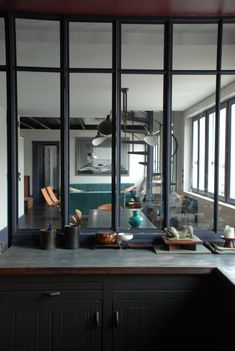 Marianne Evannou Loft/Remodelista.....love the glass wall..great solution for my kitchen re-model/dream.
