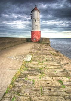 Lighthouse along the causeway (Berwick) by semi-detached on flickr