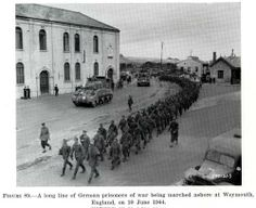 W.W. II, 6/10/44, A Long line of German prisoner of War being marched ashore at Weymouth England.