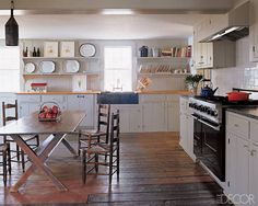 Artist Nicola Tyson's farmhouse in New Paltz, New York, is an example of Shaker-like simplicity at its best. The cabinets—designed by architect James Joseph—were inspired by mid-19th-century farmhouses; a circa-1800 sawbuck table and ladder-back chairs made in 1810 look right at home alongside ample open shelving, a soapstone sink, wide-plank wood floors, and a Viking range.