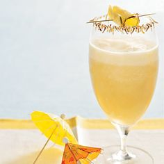 This pina colada is a tropical mixed drink that will remind you of sandy beaches and sunsets. Don't forget to toast the coconut for garnishing the rim of the glass. Happy 4th! | Health.com