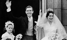 Lord Snowdon and Princess Margaret wave to onlookers from the Buckingham Palace balcony on their wedding day on 6 May 1960
