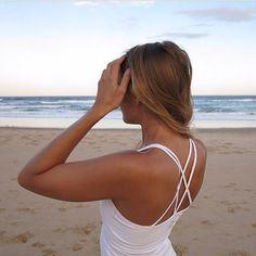 taylor tank on the beach worn by kat harding. organic cotton in this beautiful organic environment. www.yogahyde.com #hydeyoga #organicyoga #beachyoga