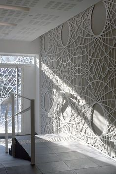 The Filigrane buiding renovation at the Grand Place of Tourcoing in Roubaix, France houses a bank and eight housing units. Semi-artisan process was used in making the concrete filigree facade. Motifs carried to interior as well. #Mar2017