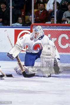 goalie-ron-hextall-of-the-quebec-nordiques-defends-the-net-during-an-picture-id147492726 (409×612) Pro Hockey, Hockey Goalie, Hockey Stuff, Quebec Nordiques, Goalie Mask, Star Wars, Cool Masks, Buy Weed Online, Mask Design