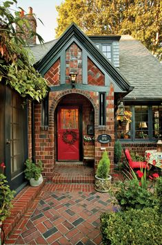 Ein Lehrbuch der Tudor in Ein Lehrbuch der Tudor in Portland The path to the front door is decoratively laid in brick. Windows at right open into the conservatory; French doors at left lead to the living room. A Textbook Tudor in Portland Exterior Paint Colors, Exterior House Colors, Paint Colors For Home, Paint Colours, Tudor House Exterior, Craftsman Exterior, Exterior Trim, Craftsman Style, Exterior Design