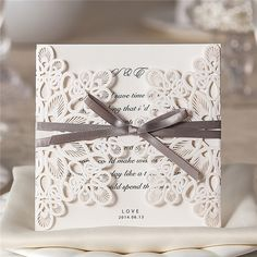 White vintage folded laser cut wedding invitations with grey ribbons - Amaze Paperie Wedding Centerpieces, Wedding Favors, Wedding Decorations, Wedding Sparklers, Wedding Supplies, Laser Cut Wedding Invitations, Wedding Invitation Wording, Wedding Cards, Wedding Events