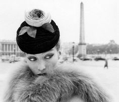 Rose hat, Parisian background, fur coat = perfection
