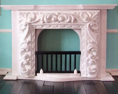 Knotty By Nature: Dollhouse Fireplace idea Found a cheap wooden fireplace and cut a frame in half to glue on the front of it. Painted it all white with acrylic. Took 3 coats