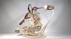 Artist Derek Hugger utilized over 400 gears, screws, and custom pieces to create Colibri, a kinetic sculpture that mimics a hummingbird. #sculpture #art