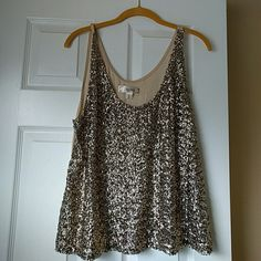 Gold sequin tank top This is a gold sequin top.  Hasn't been worn for years.  Has a small hole by the tag. Lint on the back on the bottom of the top Decree Tops Tank Tops