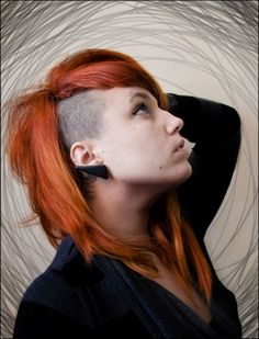 side shaved hairstyles for women 2013 | ... girl has colored her hair red. The shaved part of her hair is black
