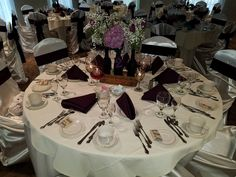 wedding table center piece with cheese box, chalkboard painted wine bottles and wine glasses filled with grape juice and small oil lamps