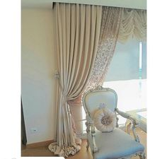 A lot going on here a tied back drape a sheer panel. Under built in valance installation and room darkening roller shade layer.