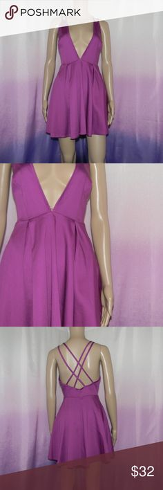 "Nasty Gal Purple Deep V Dress Size small, very good condition, criss cross back, zipper side, 97% cotton 3% spandex, 13"" bust, 32"" long, worn 3-5 times -Sorry NO TRADES and NO HOLDS -Ships from California -Comes from smoke free, dog friendly homes -I can't model at this time, the mannequin measurements are 32.5"" bust, 24"" waist, 34"" hips, and is 5'10"" and a size S/M -Items are measured by hand and done laying flat Nasty Gal Dresses Mini"