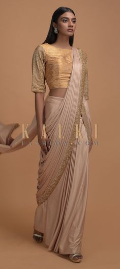 Buy Online from the link below. We ship worldwide (Free Shipping over US$100)  Click Anywhere to Tag Shrimp Beige Ready Pleated Saree In Shimmer With Embroidered Blouse Online - Kalki Fashion