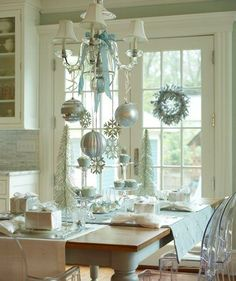 Accentuate overhead lighting with shimmery decorations and stick to a fresh winter palette like pale blue and silver.