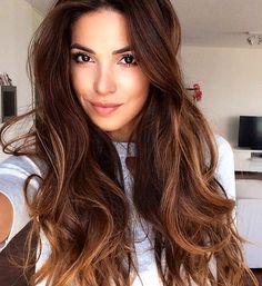 Warm brown wavy hair.