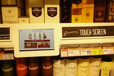 Guide to whiskey - touch screen with multiple brand pages