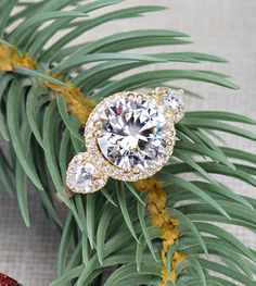 We're going to let it glow in this ring all season long! With over 6 carats of sparkle set in luxurious yellow god, this ring is guaranteed to make you the center of attention. Get ready to mix and match it with all of your holiday party attire and wow the crowd!